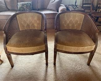 Nice pair of Mid Century barrel back chairs with cane sides and upholstered seats