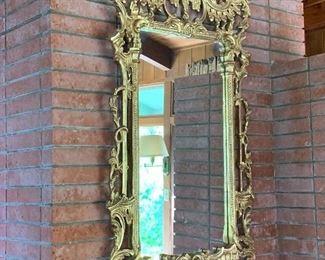Ornately gilt framed mirror