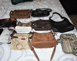 Lot of 11 purses & gloves - Etienne Aigner, Prada, Eddie Bauer           https://ctbids.com/#!/description/share/209077