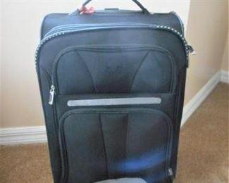 """Jeep brand suitcase - 21 1/2"""" tall & 10 3/4"""" deep      https://ctbids.com/#!/description/share/209080"""