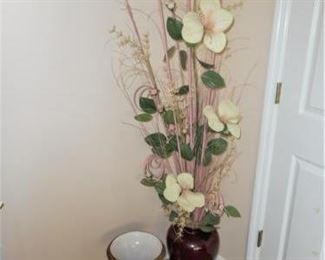 Tall floral arrangement with flowers and white ceramic urn             https://ctbids.com/#!/description/share/209089