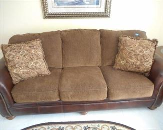 Leather & fabric sofa w/ 2 pillows - 3 cushions back ones attached https://ctbids.com/#!/description/share/209126