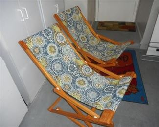 Lot of 2 wood frame and fabric patio chairs https://ctbids.com/#!/description/share/210482
