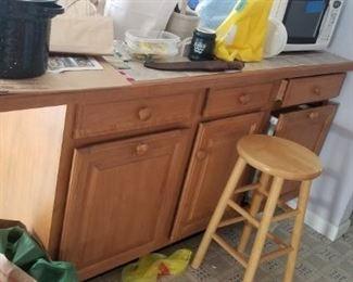 Kitchen island made of Wellborn Cabinet, Inc. cabinets