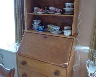 drop front bookcase/desk, teacups & saucers