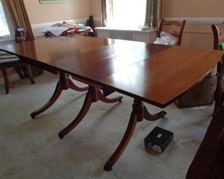 mahogany Duncan phyffe table w/2 leaves, 6 chairs w/needlepoint seats