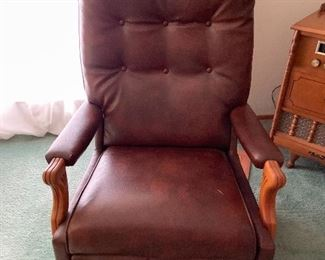Recliner with carved wooden arms
