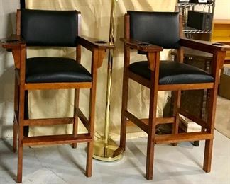 Wooden bar stools with upholstered seats. Cup holders in arms.