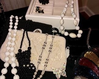 Beautiful clean costume jewelry and vintage Japanese clutch bags.