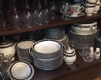 Noritake china 14 piece place setting with all serving dishes and platters. Includes coffee and tea pots