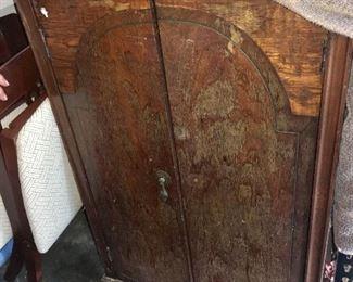 antique cabinet in garage