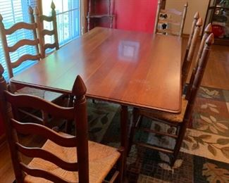 #3		drop side dining table w 6 ladder back chairs  69x19-39x29	 $275.00