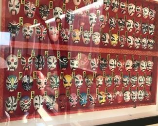 Chinese miniature masks in frame $125