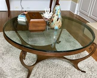 Metal coffee table with beveled glass top