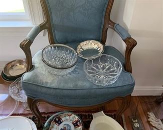 Various platters, crystal bowls, serving platters. Antique blue chair (seat needs to be recovered)