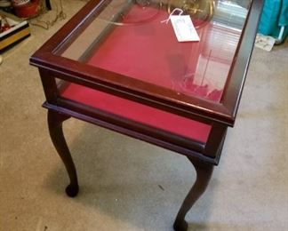 #7glass top and side display end table w qA legs 23x18x23 $100.00