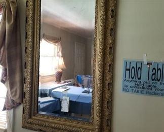 #9Antique 29x51 gold bevel mirror w carved frame design $150.00