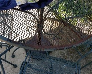 #32 metal table w 4 chairs as is rust  $75.00  without umbrella