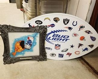 Metal Pabst and Bud Light Signs