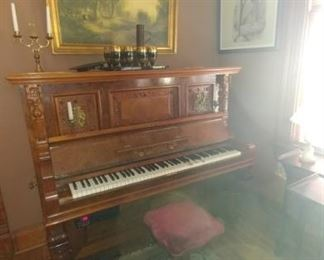 Antique piano converted to CD player piano