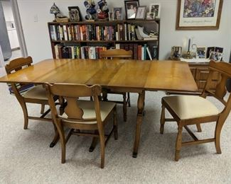 $125   Maple table with chairs and leaves