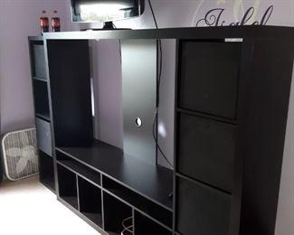 Black Wooden Entertainment Center, Flatscreen TV, Box Fan