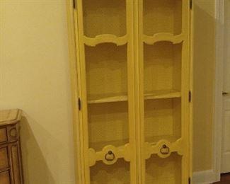 Yellow display/towel cabinet