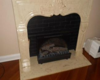 Cultured marble mantle with fireplace insert.  Visual  with fire light and generates some heat