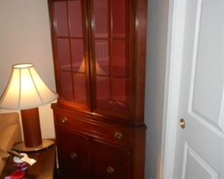Pair of corner cabinets, lighted. Beautiful condition