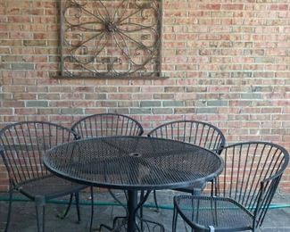 Mid century wrought iron patio set and powder coated gate wall decor