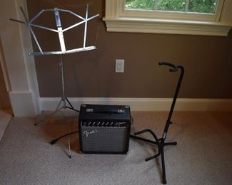 Fender Champion 20 amp, music stand and guitar stand