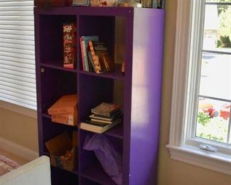Purple cubby style shelf