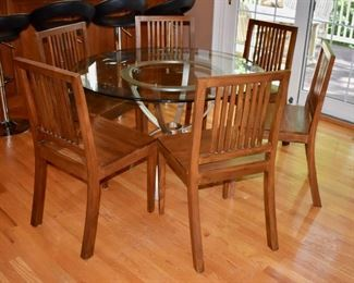 Glass and metal table and 6 wooden chairs
