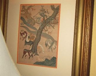 A  wonderful Asian print  of wild horses in a matted and gilded frame done by Friedman's art for over $400.00.