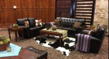 Leather lounge seating and cowhide rugs