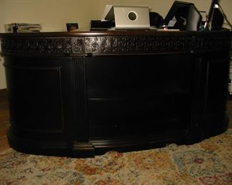 very impressive wooden rounded front desk