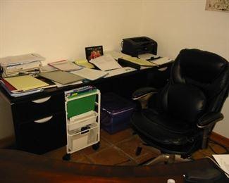 wooden desk (quite a few rolling desk chairs)