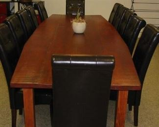 large conference table and leather slipper chairs