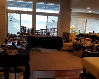 tables of vintage and modern jewelry, leather sectional couch and matching recliner in a soft yellow.