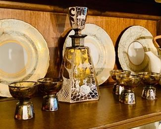 Vintage Amber/Sterling Spaniard Scene decanter set is only $175 plus tax