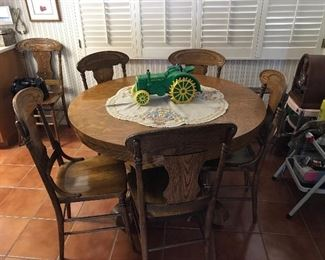 Kitchen Table with 4 leaves and multiple chairs.