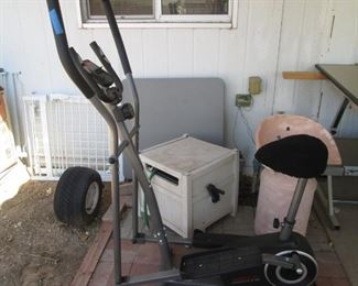 Exercycle, Garden Hose in Container, Bridge Table