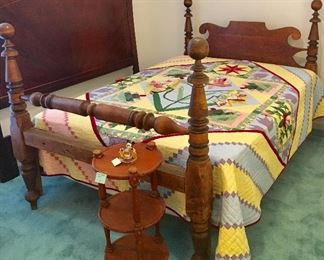 Antique rope bed converted to hold modern mattress set