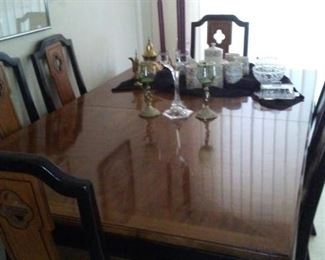 Teakwood dining table with 8 black lacquer Chairs 2 arm chairs &2 leaves