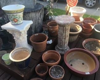 Lots of garden pots and accessories.