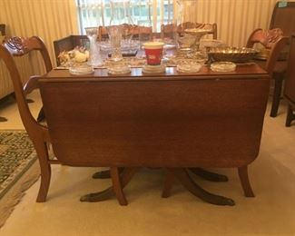Duncan Phyfe style, drop leaf table with six chairs and leaf.