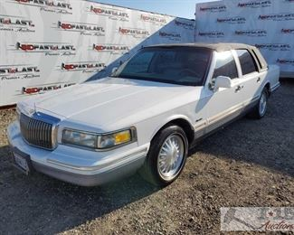 80: 1997 Lincoln Town Car, White Signature Package Leather Interior, Sunroof, steering wheel controls, power windows, power seats, cold ac Year: 1997 Make: Lincoln Model: Town Car Vehicle Type: Passenger Car Mileage: {ENTER MILEAGE HERE} Plate: 5VWV742 Body Type: 4 Door Sedan Trim Level: Signature Drive Line: RWD Engine Type: V8, 4.6L (281 CID); SOHC 16V; EFI Fuel Type: Gasoline Horsepower: Transmission: Automatic VIN #: 1LNLM82W1VY693795  Features and Notes: