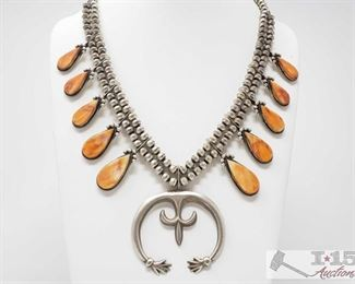 310:  Navajo Orange Spiny Squash Necklace Signed By Selena Warner, 99.3g, Orange Spiny Oyster and Sterling Silver Squash Necklace. Handmade by the Artist Selena Warner. Measuring approx 26 inches long with a 2 inch wide Naja. Beautiful piece for your summer wardrobe. Sterling Silver Necklace weighs approx. 99.3g