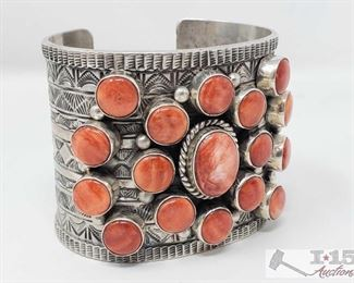 320:  Signed T. Jon Spiny Oyster & Sterling Silver Cuff/Bracelet 143.1g What a beautiful one of a kind Cuff Signed by the famous artist T. Jon and Marked Sterling  Weighs approx 143.1g Metal Type: Sterling Silver Low Estimate: 800.00 High Estimate: 1000.00