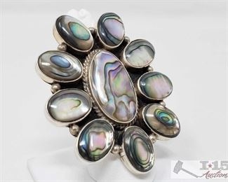 334:  Large Sterling Silver Albacore Ring, 34.3g This is a beautiful Abalone and Sterling silver Navajo cluster ring.  It is a size 8.5. 2 1/4 inches in length and just under 2 inches in width. Stamped Silver and signed by Artist.   Weighs approx 34.3g, approx size 8   Metal Type: Sterling Silver Gemstones: Abalone Low Estimate: 150.00 High Estimate: 200.00